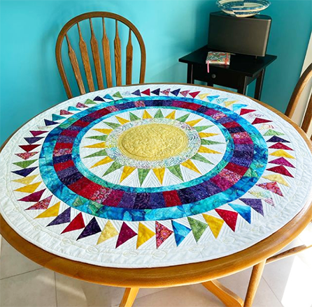 Wendy Norman  Whether you love New York Beauties or not, this quilt is sure to please! We love the stunning table topper Wendy designed using EQ8, don't you?!  See more of Wendy's work on her Instagram, @wendellmakes