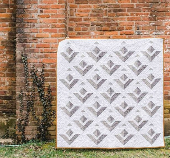 """Kiley Ferons  How """"fly"""" is Kiley's Paper Planes quilt?! She desinged it in EQ and says the pattern is perfect for confident beginners! See more of her quilts on Instagram, @kileysquiltroom."""