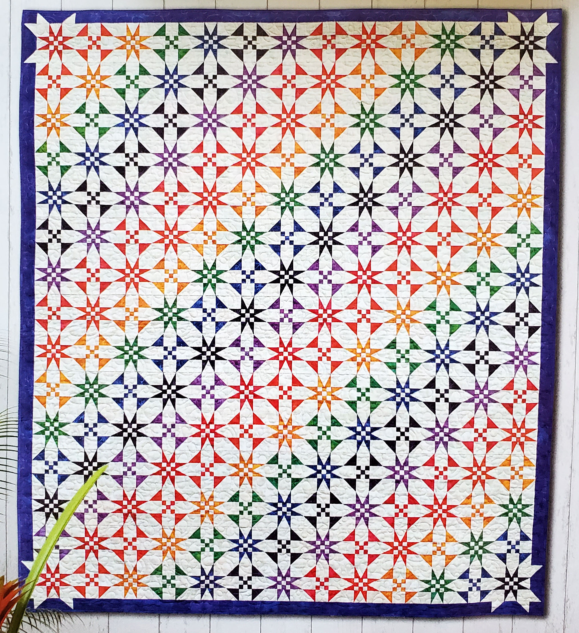 """Shelley Scott Tobisch  You can see Shelly's gorgeous """"Here Comes the Sun"""" quilt in the September issue of American Quilter! We love seeing EQ users in magazines! Find the pattern and Shelley's tips in the magazine.  Photo credit: American Quilter Magazine"""